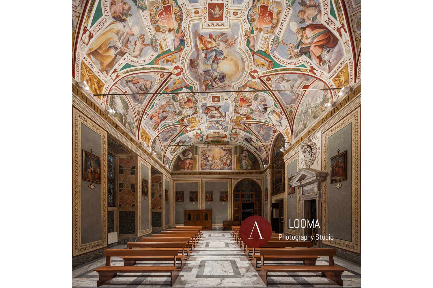 The nave of San Lorenzo in Palatio church. The frescoed ceiling vault